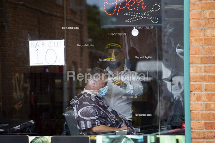 Turkish barber in a face shield cutting hair, customer wearing a face mask, Stratford Upon Avon - John Harris - 2020-07-29