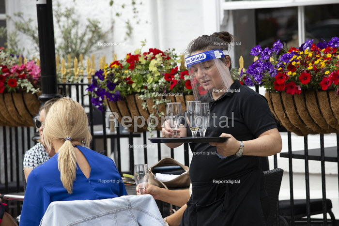 waitress in face shield searving customers table outside, Stratford Upon Avon - John Harris - 2020-07-29
