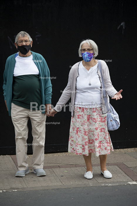 Elderly couple with face masks holding hands, Stratford Upon Avon - John Harris - 2020-07-29