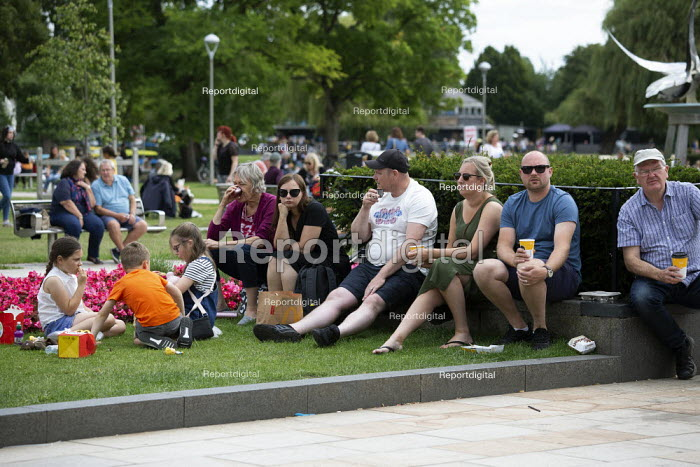 Tourists relaxing, busy Bancroft Gardens, Stratford Upon Avon. Family group and McDonald's - John Harris - 2020-07-29
