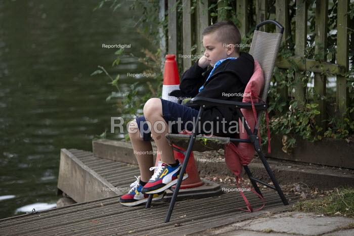 Bored boy sitting by the river, Stratford Upon Avon - John Harris - 2020-07-29