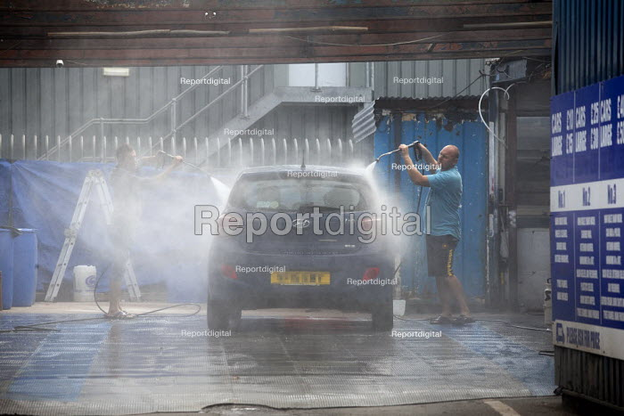 Migrant workers spray cleaning a car, Car Wash, Stratford Upon Avon - John Harris - 2020-07-29