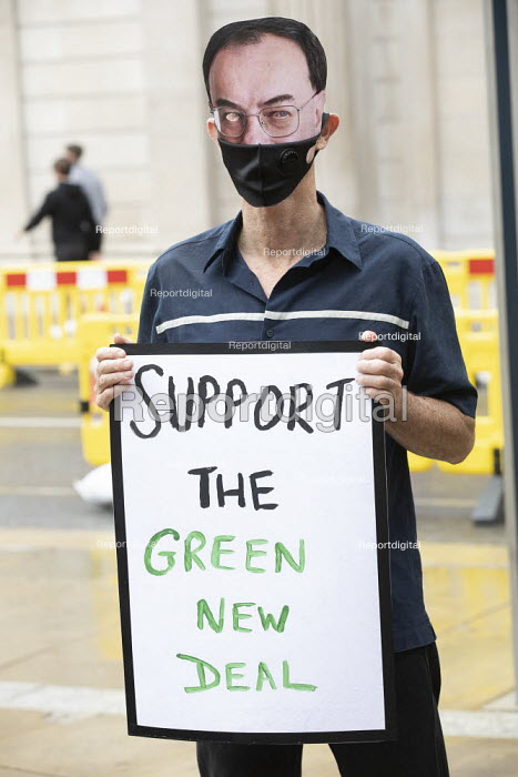 Protest for a Green Covid Recovery, Bank of England, City of London Protestors wearing Bank of England governor Andrew Bailey masks encourage investment in a Green New Deal. The Bank of England is currently supporting fossil fuel companies through its corporate quantitative easing (QE) programme - Jess Hurd - 2020-08-06