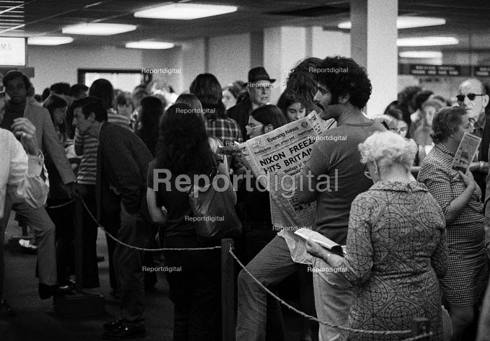 Dollar comes off The Gold Standard London 1971 Americans queuing at American Express to exchange their dollars the day after President Richard Nixon announced the end of dollar convertibility to gold. Evening News Headline: Nixon Freeze Hits Britain. It was the end of the Bretton Woods International Monetary System - Peter Arkell - 1971-08-16