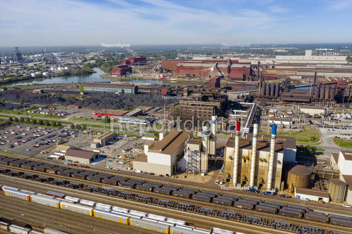 Dearborn, Michigan, USA. CSX rail yard by the Ford River Rouge industrial complex. Red, white, and blue chimneys of the Dearborn Industrial electrical generation plant - Jim West - 2020-08-12