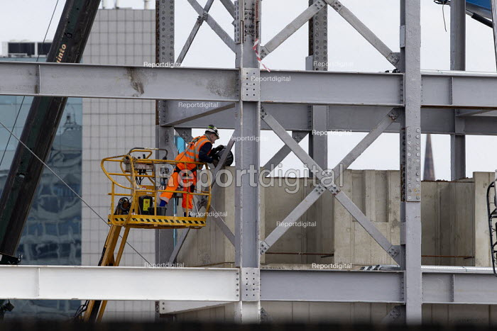 Redevelopment of Coventry Railway Station, Construction worker on a hydraulic lift amongst the girders - John Harris - 2020-08-15