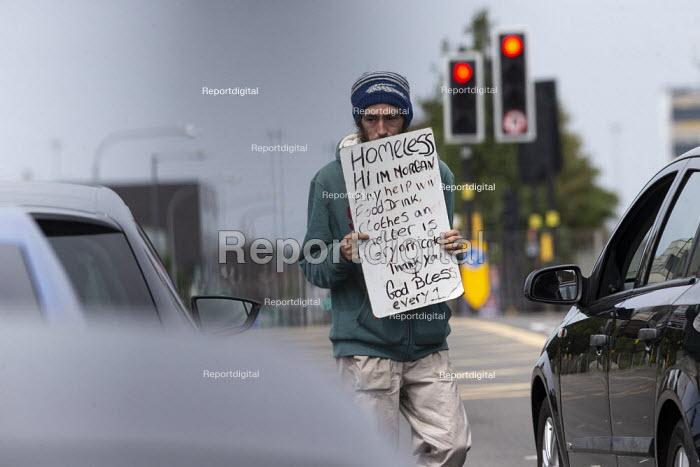 Homeless youth begging from cars waiting at traffic lights, Duddeston, Birmingham - John Harris - 2020-08-15