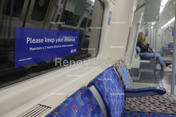 Please Keep Your Distance sign, Jubilee Line underground train, London, almost empty carriage. Easing of Covid-19 lockdown restrictions. - Philip Wolmuth - 2020-08-18