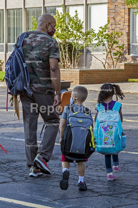 Michigan, USA, Parent bringing his children, first day of school, St. Clare of Montefalco Catholic School. The school has a diverse student body from Grosse Pointe and Detroit. - Jim West - 2020-08-27