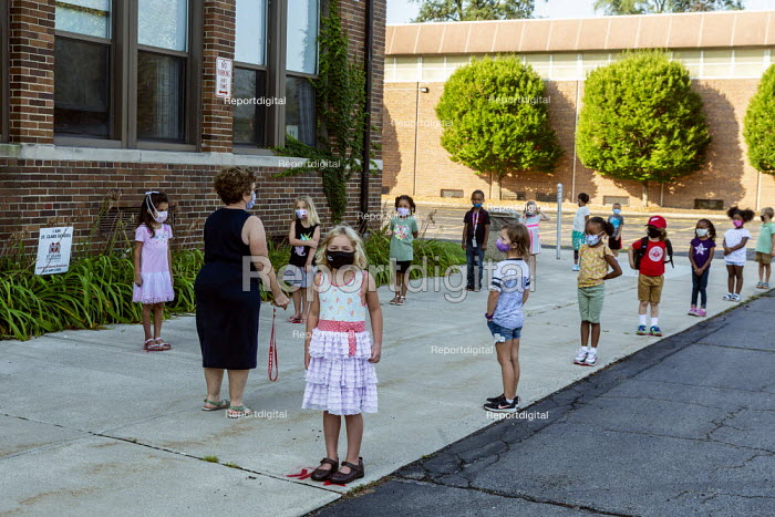 Michigan USA. First day of school, teacher helping pupils practice lining up six feet apart, St. Clare of Montefalco Catholic School. The school has a diverse student body from Grosse Pointe and Detroit. - Jim West - 2020-08-27
