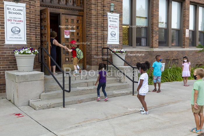 Michigan, USA, First day of school, pupils entering St. Clare of Montefalco Catholic School six feet apart. The school has a diverse student body from Grosse Pointe and Detroit. - Jim West - 2020-08-27