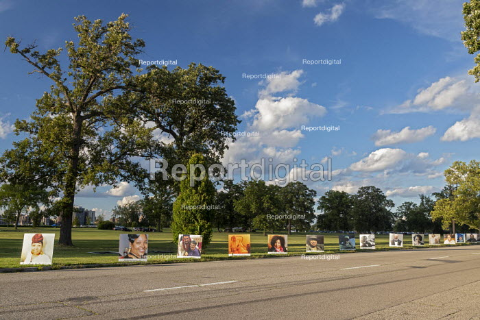 Detroit, USA: Memorial to Covid-19 Victims. 900 portraits of those lost to Coronavirus in a public memorial. Faces on billboards of Detroit residents who died lining the roads of Belle Isle State Park memorial. The nearly 900 portraits represent the 1,500 who died from the virus through to August 18. - Jim West - 2020-08-29