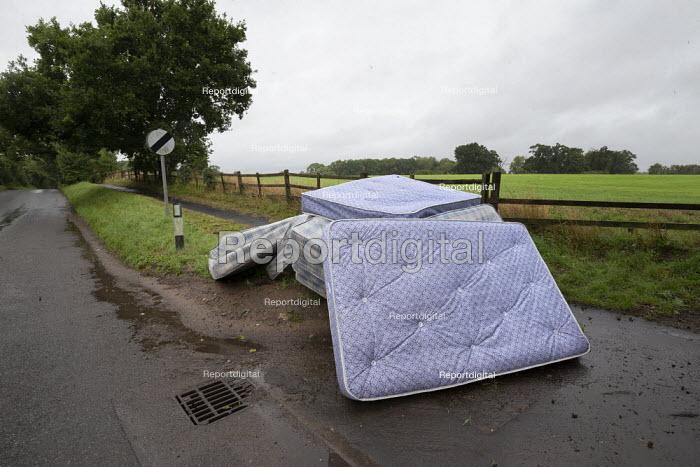 Mattresses dumped by the roadside, country lane, Charlecote, Warwickshire - John Harris - 2020-08-25