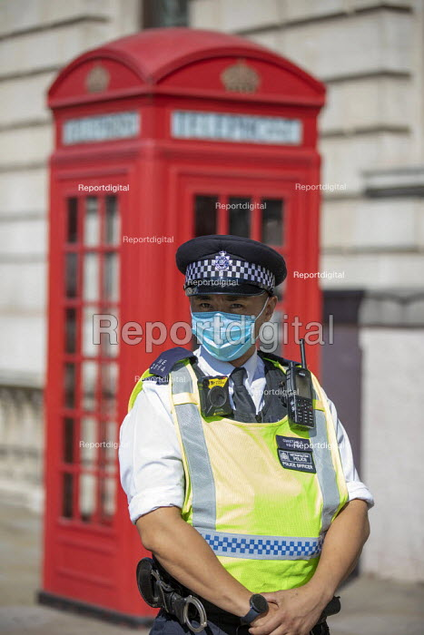 Extinction Rebellion protest blocking road to stop the Prime Minister attending PMQs, Parliament Square, London. - Jess Hurd - 2020-09-02
