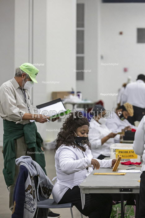 Detroit, USA-Absentee ballots, Presidential Election. Workers for the Detroit Department of Elections pre-process absentee ballots to prepare them for counting on election day. The man in the green hat is an election challenger. - Jim West - 2020-11-02