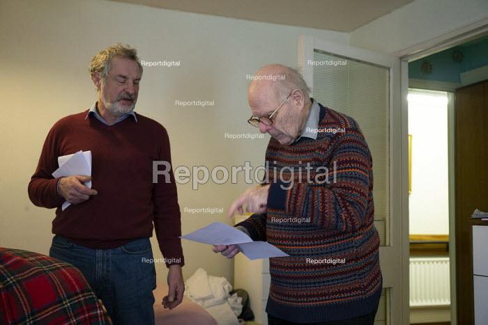 Warden explaining lockdown visitor restrictions to an elderly resident, sheltered accommodation, Broseley, Telford, Shropshire - John Harris - 2020-11-03