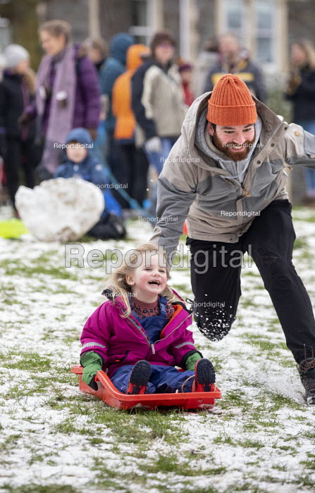Children sledging in the snow, St Andrews Park, Bristol, Paul Box - PB2101222.JPG