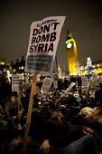 Don't Bomb Syria protest, as the debate and vote takes place in Parliament. Parliament Square. Westminster. London. - Jess Hurd - 03-12-2016