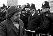 Ricky Tomlinson, one of the Shrewsbury Two jailed building workers comes out of the Shrewsbury Court 1973 where he was indicted with 23 others on conspiracy charges - Peter Arkell - 1970s,1973,at,building,Building workers strike,Building workers strike 1972,BUILDINGS,campaign campaigning,CLJ,Court,disputes,INDUSTRIAL DISPUTE,member,member members,members,people,police officer off