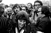 Ricky Tomlinson, one of the Shrewsbury 2 jailed building workers, is led by his wife Marlene through a scrum of supporters and journalists after his release from jail. Leicester Prison - Peter Arkell - 1970s,1975,at,building,Building workers strike 1972,BUILDINGS,campaign campaigning,disputes,INDUSTRIAL DISPUTE,industrial relations,jail,jails,journalism,journalism media,journalist,journalists,Leices