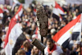 Photographs of world leaders including Barack Obama on the sole of a shoe, an Arab insult. Also a CS gas canister made in America (USA). Martyrs Day in Al-Tahrir (Liberation Square). Uprising against... - Jess Hurd - 25-11-2011