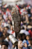 Photograph of world leaders including Barack Obama on the sole of a shoe, an Arab insult. Also a CS gas canister made in America (USA). Martyrs Day in Al-Tahrir (Liberation Square). Uprising against t... - Jess Hurd - 25-11-2011