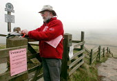 Peak Park Ranger checking foot path signs near Mam Tor, Castleton during the Foot and Mouth outbreak - David Bocking - 27-03-2001