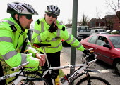 Police Hillside Community Cycle Unit, Sheffield, calling in by radio while on duty at a city centre roundabout - David Bocking - 02-05-2001