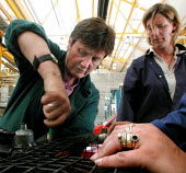 Womens motor vehicle mechanics course at Sheffield College: Tutor (left) with students - David Bocking - 24-07-2001