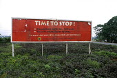 A sign erected by the Nigerian government to try and stop sabotage and people from tampering with oil pipelines in the Delta region of Nigeria. - Adrian Arbib - 10-11-1999