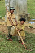 Children carrying water from a water point, which was recently rebuilt by a foreign NGO. After the previous one had been destroyed, during the conflicts between the Pro-Indonesian militia and the rebe... - Boris Heger - (ICRC),(NGO),2000s,2004,agricultural,agriculture,aid,armed forces,Asia,asian,asians,assistance,BME minority ethnic,bottle,bottles,boy,boys,capital,carries,carry,carrying,child,CHILDHOOD,children,citie