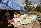 A family living in a temporary shelter, as their house was destroyed during the conflicts between the Pro-Indonesian militia and the rebel forces, in the East Timor Crisis. - Boris Heger - 14-04-2004