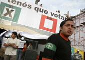 A member of the UJC (Youth Union of Santa Cruz) an far right group standing in front of a poster representing a voting paper for the yes reading you have to vote during the Campaign for the autonomy o... - Boris Heger - 2000s,2008,americas,Amerindian,Amerindians,autonomist,autonomists,autonomy,banner,banners,Bolivia,Bolivian,Bolivians,Cruz,democracy,division,far right,far right,Fascism,fascist,group,groups,Latin Amer