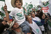 An autonomist boy is being hold by his father during the Campaign for the autonomy of the province of Santa Cruz. - Boris Heger - 2000s,2008,activist,activists,americas,Amerindian,Amerindians,autonomist,autonomists,autonomy,Bolivia,Bolivian,Bolivians,CAMPAIGN,campaigner,campaigners,CAMPAIGNING,CAMPAIGNS,child,CHILDHOOD,CHILDREN,