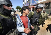 Riot policemen arrest an anti autonomist whose group just ransacked a polling station and stole the ballot boxes in Santa Cruz, on Sunday, May 4, 2008. Campaign against the autonomy of the province of... - Boris Heger - 2000s,2008,activist,activists,adult,adults,against,americas,Amerindian,Amerindians,anti,armed,arms,arrest,arrested,arresting,arrests,autonomist,Bolivia,Bolivian,Bolivians,box,boxes,CAMPAIGN,campaigner