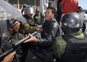 Anti riot policemen arrest an anti autonomist who grabbed a teargas launcher and just ransacked a polling station and stole the ballot boxes in Santa Cruz, on Sunday, May 4, 2008. Campaign against the... - Boris Heger - 2000s,2008,activist,activists,adult,adults,against,americas,Amerindian,Amerindians,anti,armed,arms,arrest,arrested,arresting,arrests,autonomist,Bolivia,Bolivian,Bolivians,box,boxes,CAMPAIGN,campaigner