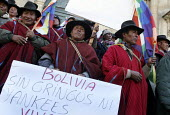 "Members of the Ponchos rojos (red coats), an indigenous group supporting the President, hold anti american and anti ""gringos"" posters (Bolivia without gringos or yankees) as they protest and block the... - Boris Heger - 22-10-2008"