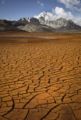 The cracked dried up mud of a reservoir which supplies water to the city of La Paz below the Huayna Potosi Mountain. The glaciers in the Andes are retreating, reducing the level to far lower than norm... - Boris Heger - 22-11-2009