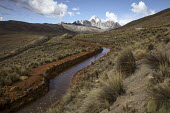 A water course supplying a reservoir which supplies water La Paz city below the Huayna Potosi Mountain. The glaciers in the Andes are retreating, reducing the level to far lower than normal. Run-off f... - Boris Heger - 22-11-2009