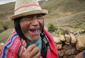 An elderly coca farmer laughing while chewing coca leaves in the Chapare region, know for its production of coca leaves, regarded as a medicinal plant. Bolivia. - Boris Heger - 10-12-2009