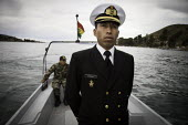 A lieutenant onboard a patrol boat. Bolivian seamen during exercises on Lake Titicaca, Bolivia. - Boris Heger - 2010,2010s,americas,Amerindian,Amerindians,Armed Forces,BOAT,boats,Bolivia,Bolivian,Bolivian Naval Force,Bolivians,crew,crewman,crewmen,crewmenmaritime,lake,lakes,Latin America,lieutenant,male,man,mar