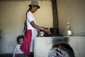 A woman cooking for children at a school, as part of a state sponsored help program in Bolivia. - Boris Heger - 2010,2010s,adult,adults,americas,Amerindian,Amerindians,Bolivia,Bolivian,Bolivians,BREAK,child,CHILDHOOD,children,cook,COOKERY,cooking,cooks,daughter,DAUGHTERS,DINNER,dinners,DINNERTIME,edu,educate,ed