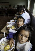 Children receiving a free meal at their school, as part of a NGO and state sponsored food program in Bolivia. - Boris Heger - 10-03-2010