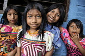 Primary school pupils waiting for their lesson to start. This village of Indigenous Tule have been displaced by conflict, to the Panama border region of the Darien gap. There are only a few thousands... - Boris Heger - 04-05-2010
