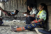 A Tule family relaxing outside their hut. This village of Indigenous Tule have been displaced by conflict, to the Panama border region of the Darien gap. Their culture is based on a strong relationshi... - Boris Heger - 04-05-2010