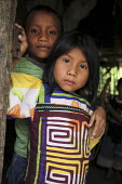 Tule children. This village of Indigenous Tule have been displaced by conflict, to the Panama border region of the Darien gap. Their culture is based on a strong relationship with the land and so losi... - Boris Heger - 05-05-2010