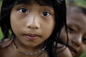 Primary school pupils waiting for their lesson to start. This village of Indigenous Tule have been displaced by conflict, to the Panama border region of the Darien gap. Their culture is based on a str... - Boris Heger - 2010,2010s,americas,Amerindian,Amerindians,border,boy,boys,child,CHILDHOOD,children,communities,community,conflict,Cuna,darien,Darien Gap,Darien National Park,displaced,displacement,Dule,face,faces,fe