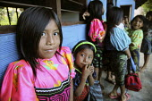 Primary school pupils waiting for their lesson to start. This village of Indigenous Tule have been displaced by conflict, to the Panama border region of the Darien gap. There are only a few thousand T... - Boris Heger - 06-05-2010