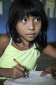 Tule pupils attending primary school. This village of Indigenous Tule have been displaced by conflict, to the Panama border region of the Darien gap. There are only a few thousands Tule left and their... - Boris Heger - 06-05-2010