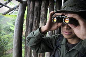 FARC guerilla observe an army position prior to their attack - Boris Heger - 2010,2010s,americas,Amerindian,Amerindians,armed,Armed Forces,arms,army,attack,attacking,BINOCULAR,binoculars,Civil War,Colombia,Colombian,Colombians,columbian,columbians,communism,Communist Party,com